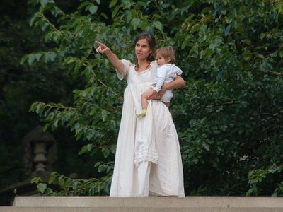 A human angel with young child points toward the horizon at Green-Wood Cemetery's annual Angels and Accordions Festival