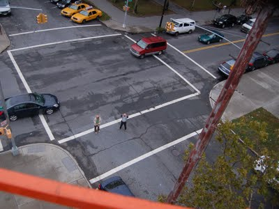 Our aerial ascension is photographed by those tiny figures in the street.