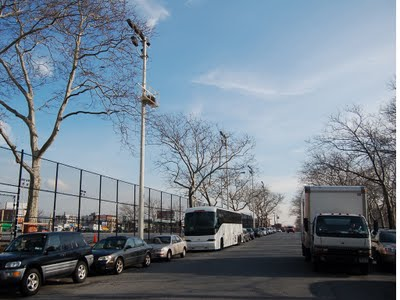 A row of four newly rebuilt stadium lights on 66th Street. Two of these lights (the nearest and furthest from the camera) have been retrofitted with parrot-friendly access platforms. The same feature is present on the row of lights on 65th Street. Photo by Steve Baldwin, taken December 14, 2009.