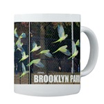 Wild urban parrot coffee mug
